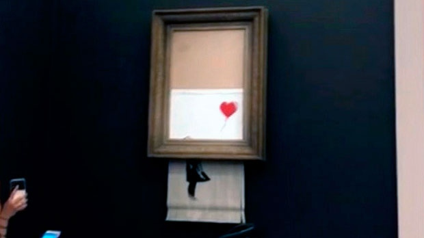 Photo of Winning bidder for Banksy painting that self-destructed goes through with purchase