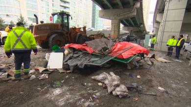 Photo of City crews demolish homeless encampment under Gardiner Expressway
