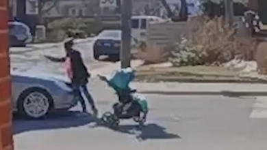 Photo of 'There's a child in there!': Security video captures vehicle nearly striking woman with stroller