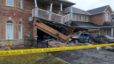 Photo of TTC driver charged after bus slammed into 2 homes in Scarborough last week