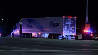 Photo of Transport truck driver charged after going wrong way on QEW for 8.5 km
