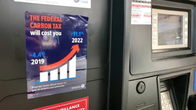 Photo of Anti-carbon-tax stickers falling off gas pumps, Ford vows to fix the problem