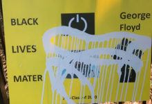 Photo of Grade 6 students made posters about anti-Black racism. Someone vandalized them with paint