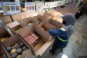 Volunteers are pictured here working at the Daily Bread Food Bank's Toronto warehouse-Milenio Stadium-Canada