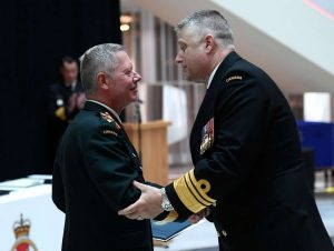 Commander of the Military Personnel Command Vice-Admiral Haydn Edmundson at right used to report to Jonathan Vance-Milenio Stadium-Canada