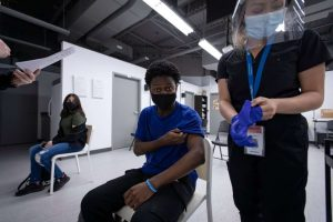 Black Creek Community Health volunteer gets his vaccine-Milenio Stadium-Canada